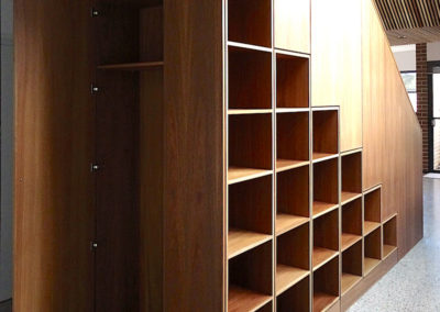 Built in stairway bookcase with balustrade and integrated robe (spotted gum) Fremantle.