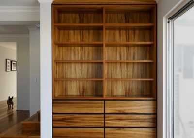 built in bookcase with drawers