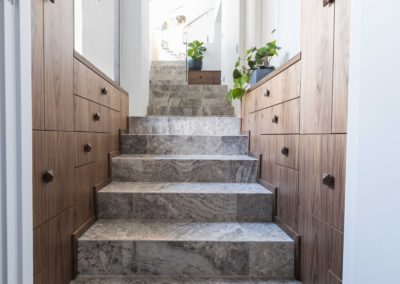 Stunning drawer cabinetry through a stair entrance, Perth.