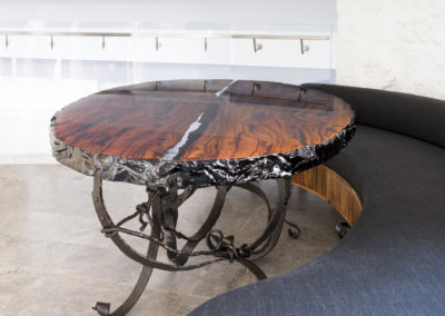 Luxurious dinning table with see-through river running through the centre, West Australian Marri Slab wood